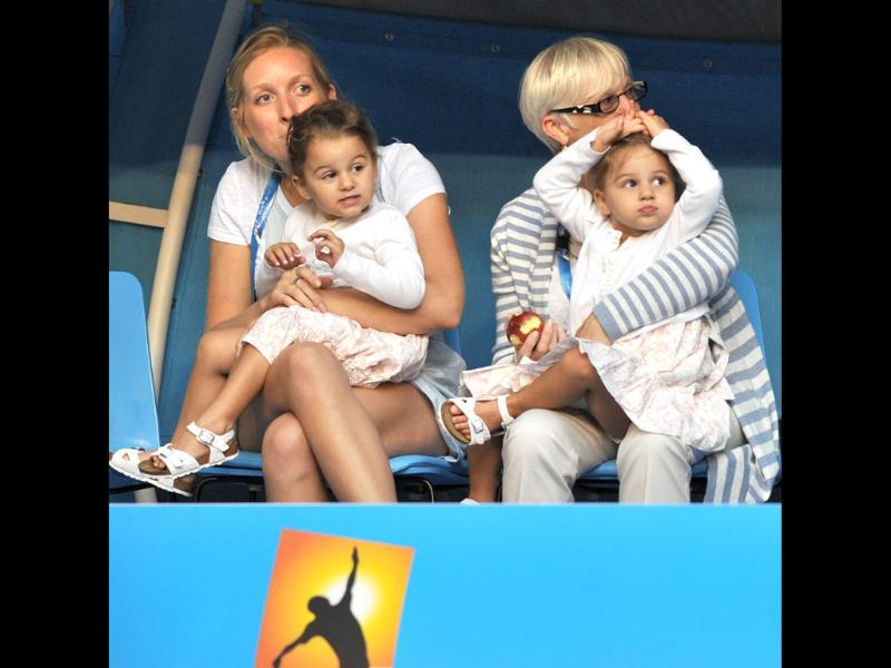 Twin daughters of Roger Federer, Myla Rose and Charlene Riva, watch their father play against Rafael Nadal in their men's singles semifinal match on day 11 of the 2012 Australian Open tennis tournament in Melbourne. AFP Photo/Paul Crock