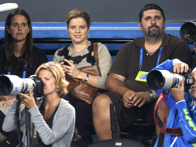 Kim Clijsters of Belgium watches from the photographer's seating area during the men's singles semifinal match between Roger Federer and Rafael Nadal at the Australian Open tennis tournament in Melbourne. Reuters/Vivek Prakash