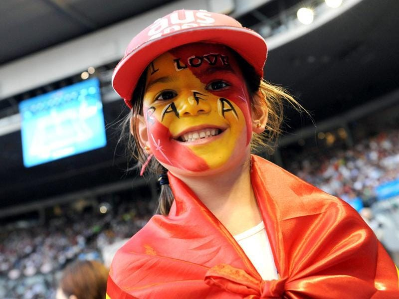 Six-year-old Ines Wood displays her painted face to support Rafael Nadal as he plays Roger Federer in their men's singles semifinal match on day 11 of the 2012 Australian Open tennis tournament in Melbourne. AFP Photo/Torsten Blackwood