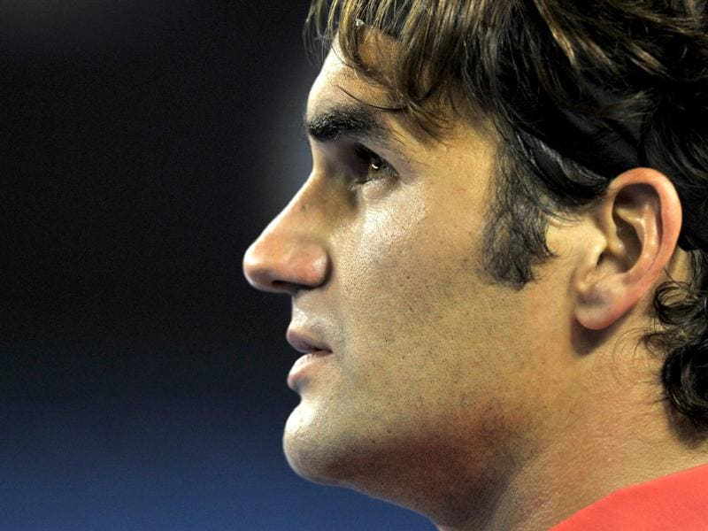 Roger Federer looks up into the crowd during a break between games against Rafael Nadal in their men's singles semifinal match on day 11 of the 2012 Australian Open tennis tournament in Melbourne. AFP Photo/Paul Crock