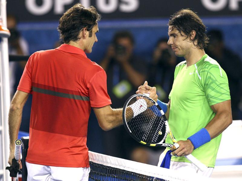 Rafael Nadal of Spain (R) and Roger Federer of Switzerland shake hands at the net after Nadal won their semifinal match at the Australian Open tennis championship, in Melbourne. AP Photo/Rick Rycroft