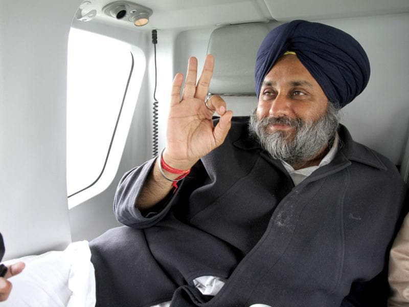 Deputy CM of Punjab and president SAD party Sukhbir Singh Badal on board his chopper while campaigning for the assembly elections. (HT photo/Rajnish Katyal)