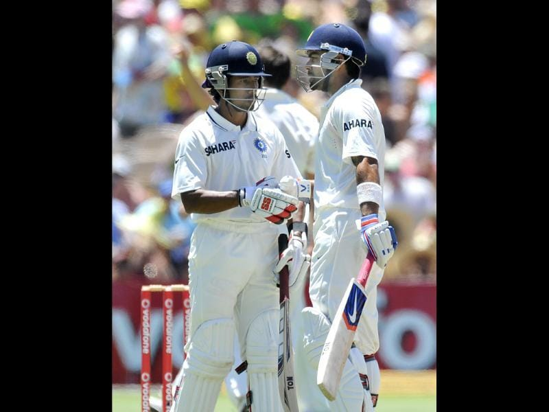 Wriddhiman Saha (L) congratulates Virat Kohli on his 50 runs against Australia during their cricket Test match in Adelaide. AP Photo/David Mariuz