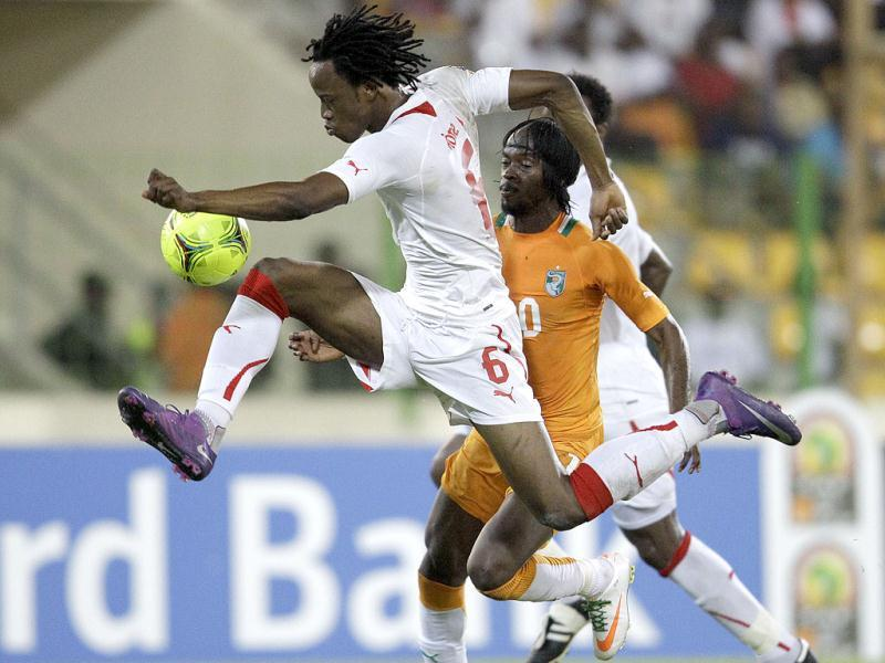 Burkina Faso's Bakary Kone, left, sails past Ivory Coast's Gervinho in their African Cup of Nations Group B match, at Malabo Stadium in Malabo, Equatorial Guinea, Thursday, Jan. 26, 2012. Ivory Coast defeated Burkina Faso 2-0. AP