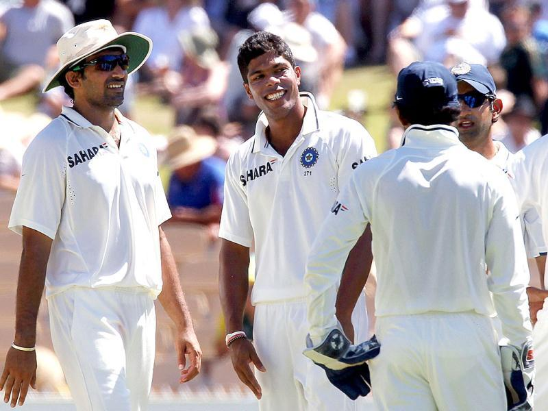 Umesh Yadav with teamates after taking the wicket of Michael Clarke on day 4 of the fourth cricket Test match in the Border-Gavaskar Trophy Series at the Adelaide. AFP