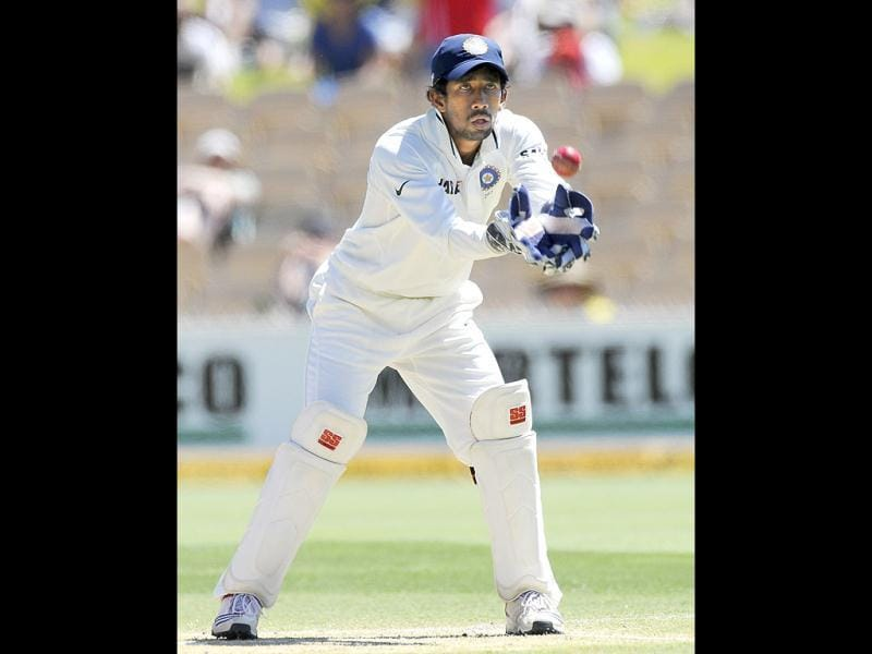 Wriddhiman Saha fields against Australia during their cricket test match in Adelaide, Australia. AP