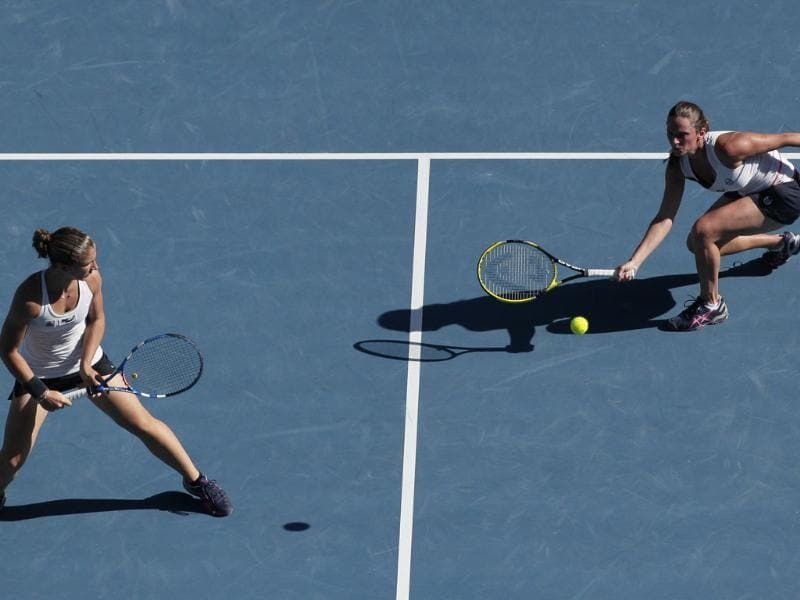 Italy's Sara Errani, left, and Roberta Vinci play a shot against Russia's Svetlana Kuznetsova and Vera Zvonareva during the women's doubles final at the Australian Open. AP/John Donegan