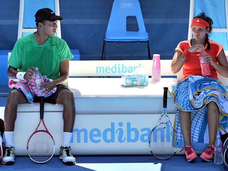 Sania Mirza and Mahesh Bhupathi take a break between games against Bethanie Mettek-Sands of the US and Horia Tecau of Romania in their mixed-doubles semi-final match on day 12 of the 2012 Australian Open. AFP/Nicolas Asfouri