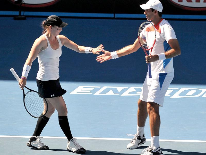 Bethanie Mettek-Sands of the US and Horia Tecau of Romania celebrate winning a point against Mahesh Bhupathi and Sania Mirza in their mixed-doubles semi-final match on day 12 of the 2012 Australian Open. AFP/Nicolas Asfouri