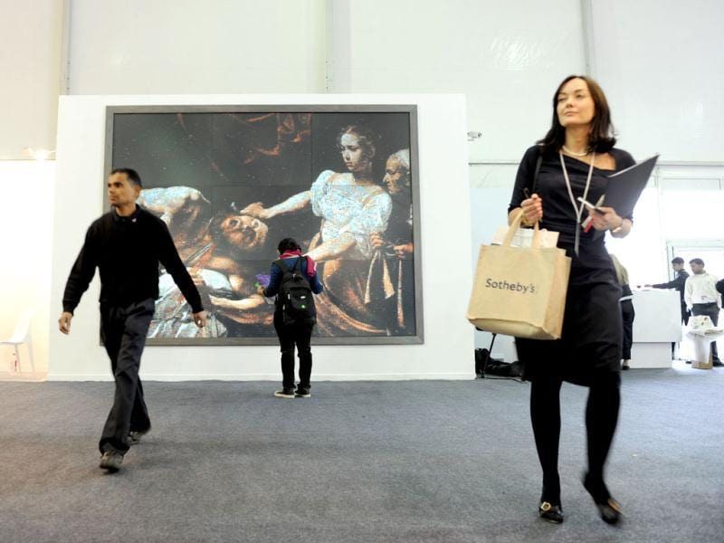 Visitors are pictured at the India Art Fair in New Delhi. The first works by Van Gogh and Picasso to be auctioned by an Indian gallery are on display at a luxury hotel in New Delhi. AFP Photo/Sajjad Hussain