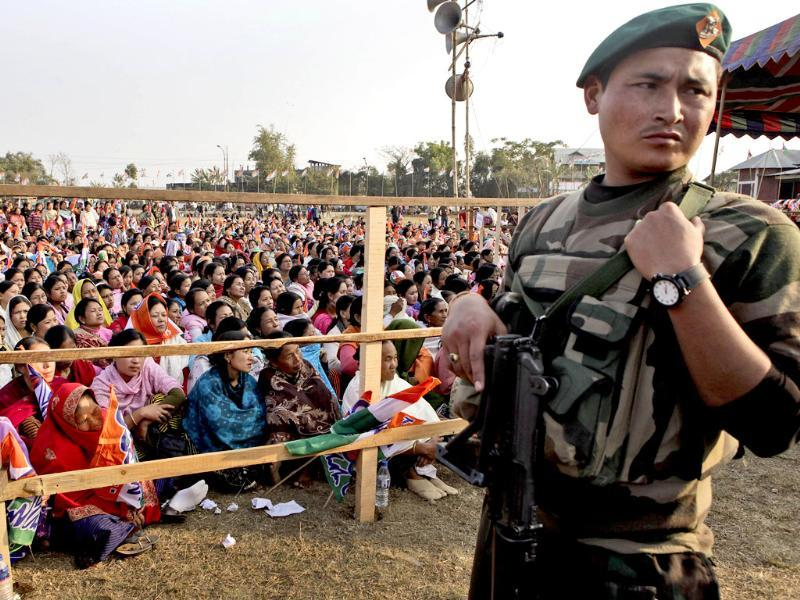 A security personnel stands guard at the site of the Trinamool Congress leader and West Bengal chief minister Mamata Banerjee election campaign rally, in Langjing, on the outskirts of Imphal. AP/Anupam Nath