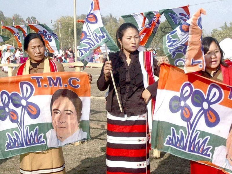 Trinamool Congress supporters are seen during party chief Mamata Banerjee's election campaign rally in Imphal. PTI