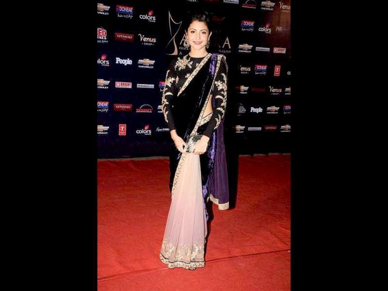 Anushka donned an unusual sari with a mix of velvet and net, beautiful nevertheless.