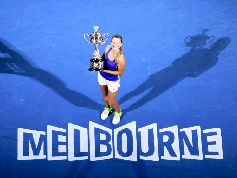 Victoria Azarenka of Belarus poses with her trophy after defeating Maria Sharapova of Russia in their women's singles final match at the Australian Open tennis tournament in Melbourne. Azarenka won 6-3. 6-0. Reuters/Daniel Munoz