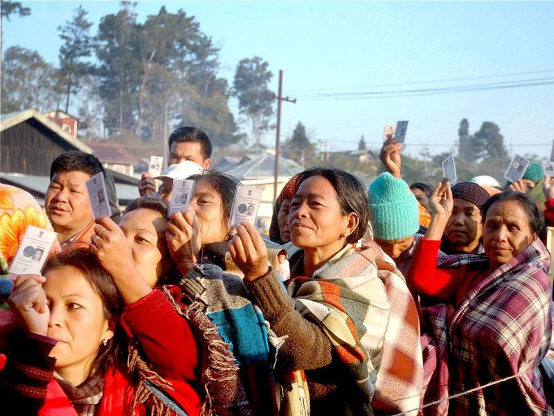 Women voters wait in queues to cast their votes at a polling station during assembly polls at Kangpokpi in Senapati district. PTI Photo