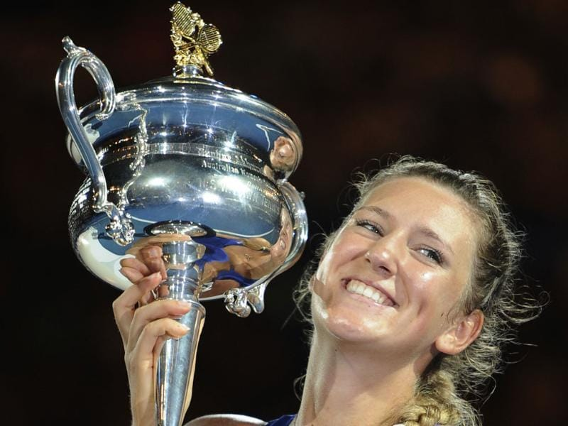 Victoria Azarenka holds the trophy aloft during the awarding ceremony after defeating Maria Sharapova. AP/Andrew Brownbill