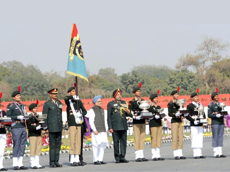 Prime Minister Manmohan Singh poses with the National Cadet Corps (NCC) award winners during the Prime Minister's rally parade in New Delhi. The NCC rally started with the presentation of a Guard of Honour by the Army, Navy and Air Force wing of the NCC to Prime Minister Manmohan Singh. AFP/Raveendran