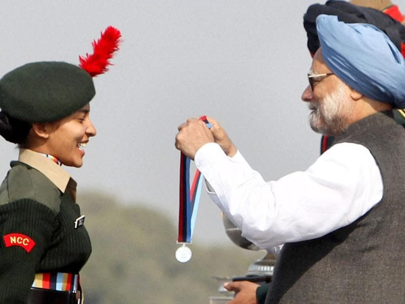 Prime Minister Manmohan Singh presents a medal to a cadet at NCC PM's rally in New Delhi. The NCC rally started with the presentation of a Guard of Honour by the Army, Navy and Air Force wing of the NCC to Prime Minister Manmohan Singh. PTI/Manvender Vashist