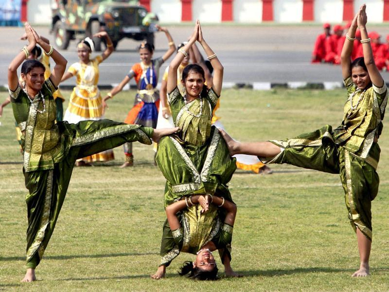 National Cadet Corps (NCC) cadets perform a cultural programme at NCC PM's rally in New Delhi. PTI/Manvender Vashist