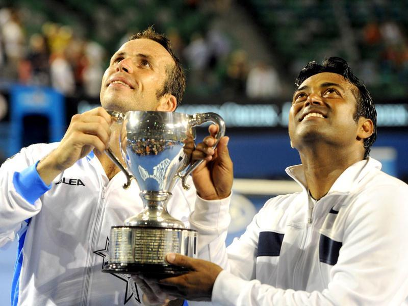 Leander Paes and partner Radek Stepanek of the Czech Republic pose with the trophy after their victory over Bob Bryan of the US and Mike Bryan of the US in the men's doubles final at the Australian Open tennis tournament in Melbourne. (AFP photo /William West)