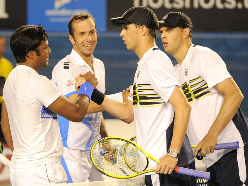 Leander Paes and Radek Stepanek of Czech Republic shake hands after victory in their men's doubles final against Bob and Mike Bryan of the US at the Australian Open tennis tournament in Melbourne. (AFP photo /William West)