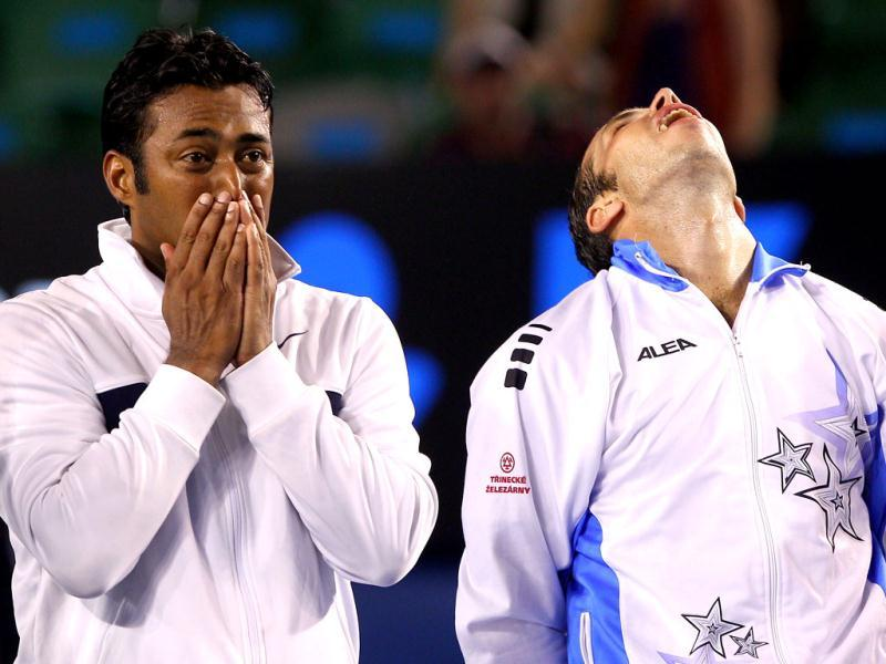 Leander Paes and Radek Stepanek of Czech Republic celebrate after their victory in men's doubles final against Bob and Mike Bryan of the US at the Australian Open tennis tournament in Melbourne. (AFP photo /William West)