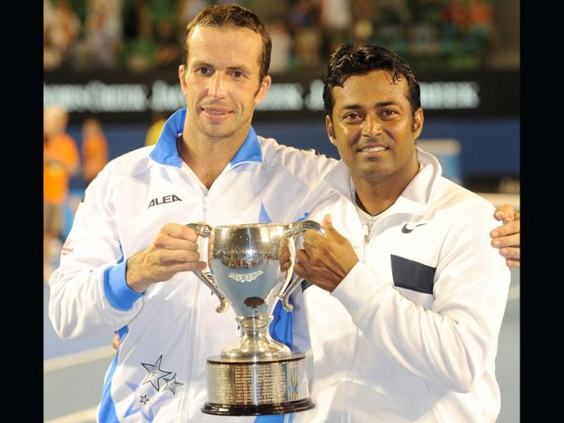 Leander Paes and Radek Stepanek of Czech Republic pose with the trophy after victory in their men's doubles final against Bob and Mike Bryan of the US at the Australian Open tennis tournament in Melbourne. (AFP photo /William West)