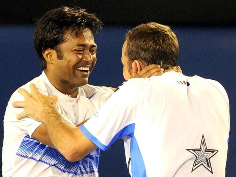 Leander Paes and Radek Stepanek of Czech Republic celebrate after victory in their men's doubles final against Bob and Mike Bryan of the US at the Australian Open tennis tournament in Melbourne. (AFP photo /William West)