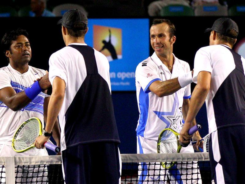 Leander Paes and Radek Stepanek of Czech Republic shake hands after victory in their men's doubles final against Bob and Mike Bryan of the US at the Australian Open tennis tournament in Melbourne. (AFP photo/Cameron Spencer)