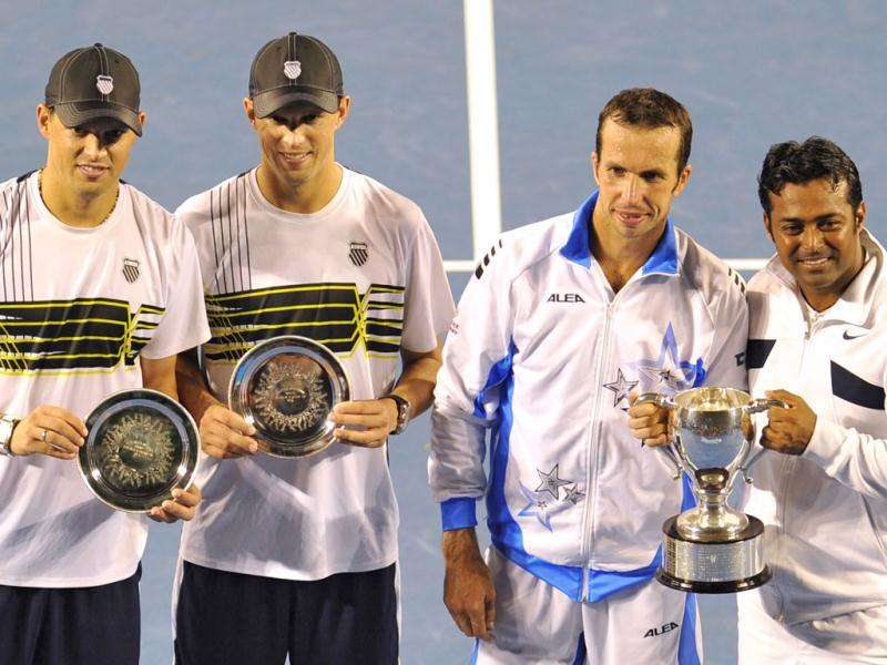Leander Paes and partner Radek Stepanek of the Czech Republic pose with the trophy after their victory over runners up Bob Bryan of the US (L) and Mike Bryan of the US (2nd L) in the men's doubles final at the Australian Open tennis tournament in Melbourne. (AFP photo /Nicolas Asfouri)