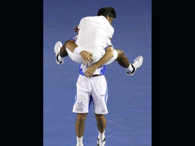 Leander Paes, top, and Radek Stepanek of the Czech Republic celebrate after defeating USA's Bob Bryan and Mike Bryan during their men's doubles final at the Australian Open tennis championship, in Melbourne. (AP Photo/Aaron Favila)