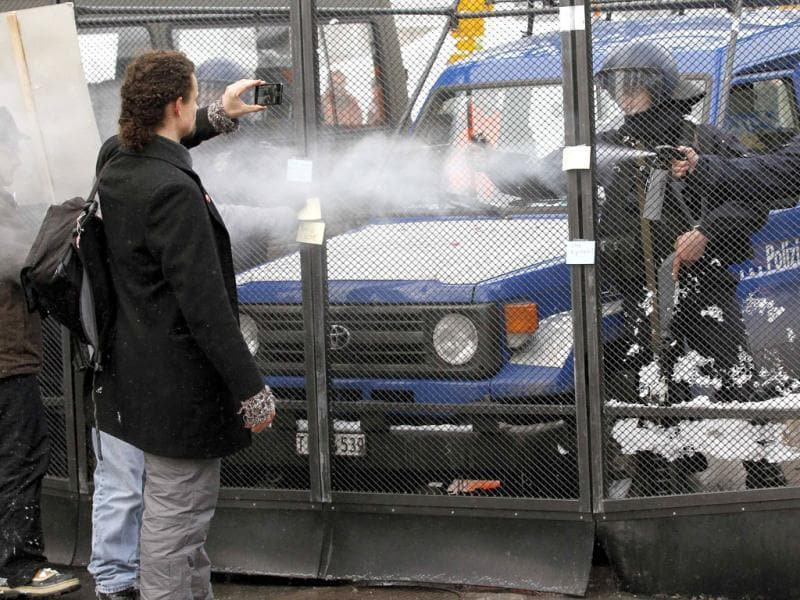 Swiss riot police spray tear gas towards protestors during a demonstration against the World Economic Forum (WEF) in the Swiss mountain resort of Davos.(Reuters/Arnd Wiegmann)