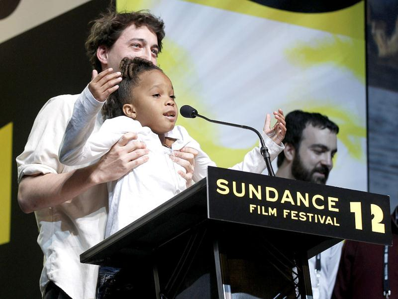Director Benh Zeitlin holds up actress Quvenzhane Wallis as they accept the Grand Jury Prize Dramatic award for the film Beasts of the Southern Wild during the 2012 Sundance Film Festival Awards Ceremony in Park City, Utah. AP
