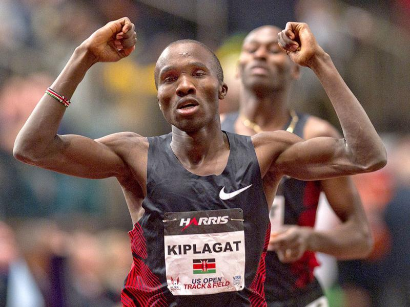 Silas Kiplagat of Kenya reacts at the finish line after beating Bernard Lagat (rear) of the US in the men's 1 mile run at the US Open Track and Field meet at Madison Square Garden in New York. Reuters
