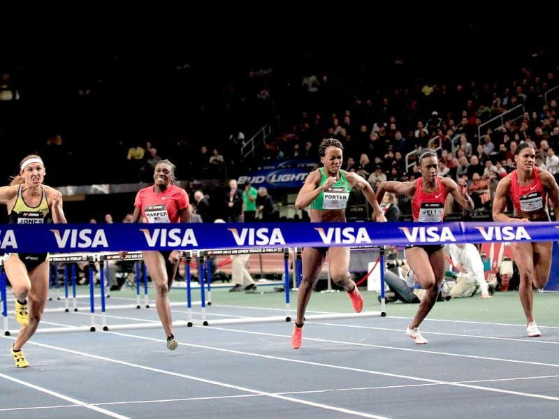 Lola Jones runs to victory in the Women's Meter Hurdles at the US Open Track and Field event at Madison Square Garden in New York City. AFP