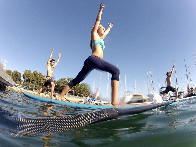 Instructor Sarah Tiefenthaler (C) demonstrates a pose during her Yogaqua class, which combines yoga and paddleboarding, in Marina Del Rey, Los Angeles. (REUTERS/Lucy Nicholson)