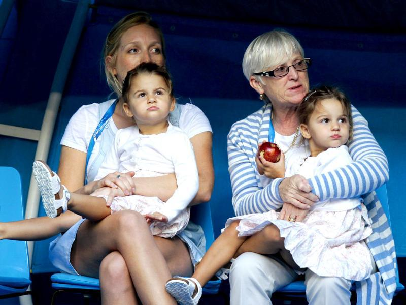 Charlene Riva and Myla Rose, twin daughters of Roger Federer, watch the men's singles match between their father and Alexander Kudryavtsev of Russia at the Australian Open tennis tournament in Melbourne. (Reuters)