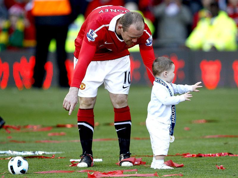 Manchester United's Wayne Rooney plays with his son Kai following their English Premier League soccer match against Blackpool at Old Trafford. (Reuters)