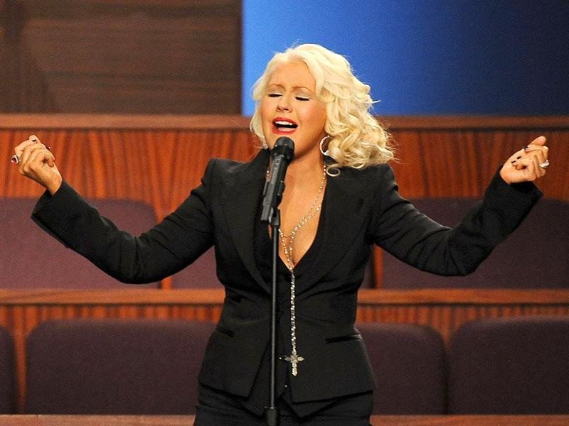 Singer Christina Aguilera performs at the Etta James' funeral, in Gardena, California. (AFP PHOTO/Valerie Macon)