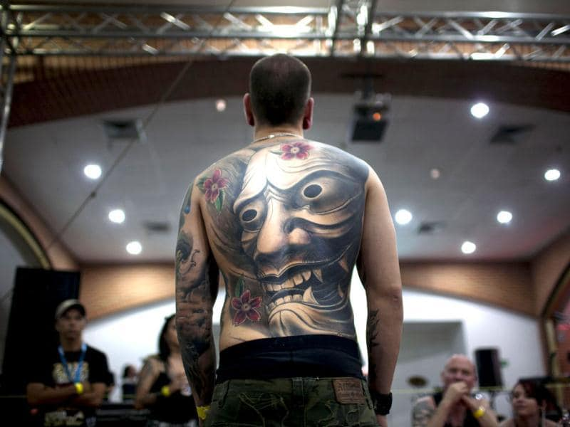 A man shows his tattoos as he attends Venezuela Expo Tattoo in Caracas, Venezuela. Artists gather in Caracas to show this art, which also uses implants in the face and cuts in the skin. AP/Ariana Cubillos