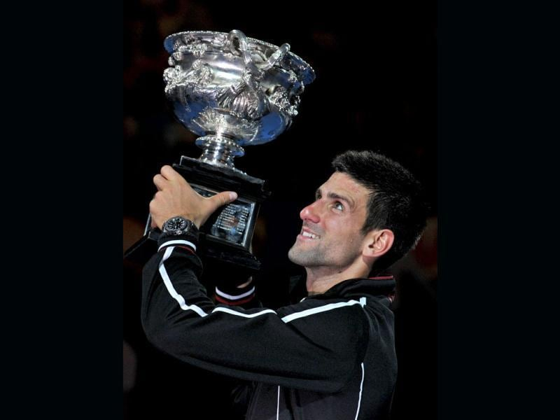 Novak Djokovic of Serbia poses with the trophy after his victory over Rafael Nadal of Spain in the men's final match at the 2012 Australian Open in Melbourne. (AFP photo/Paul Crock)