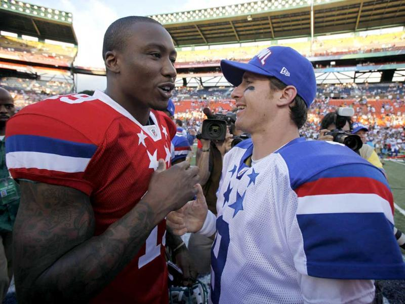 AFC wide receiver Brandon Marshall of the Miami Dolphins (L) talks with quarterback Drew Brees of the New Orlean Saints after the NFL Pro Bowl at Aloha Stadium in Honolulu, Hawaii. Reuters/Hugh Gentry