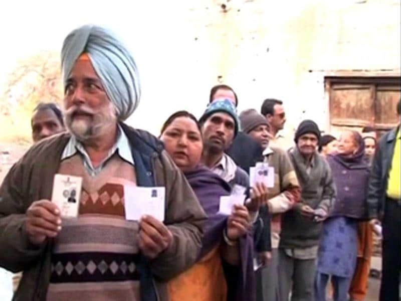 Voters flash their election cards before casting their votes during the assembly elections in Punjab. (ANI Photo)