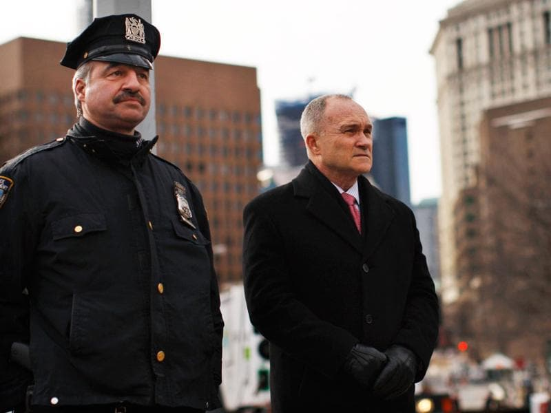 New York City Police Commissioner Raymond Kelly (R) attends a Chinese New Year parade next to a NYPD police officer at Chinatown in New York. (REUTERS/Eduardo) Munoz)
