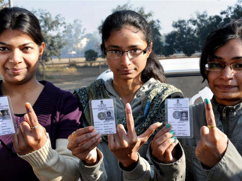 First time voters show their marked fingers after casting their votes at a polling station during assembly polls in Amritsar. PTI Photo/Deepak Sharma