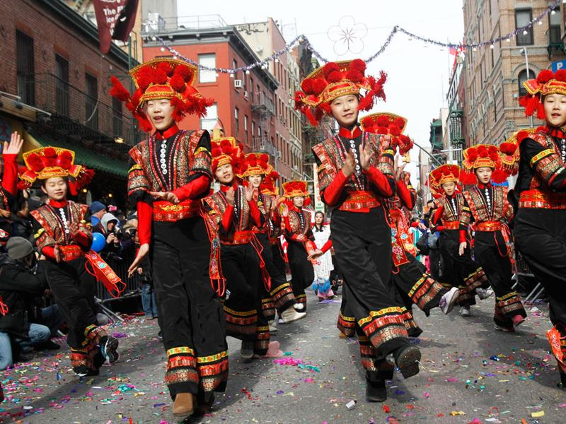 Members of a Beijing dance troupe perform during the Chinese Lunar New Year parade in Chinatown in New York, Sunday, Jan. 29, 2012. The parade marks the Year of the Dragon, which is the luckiest year on the lunar calendar. In ancient times the dragon was a symbol reserved for the Chinese emperor. (AP Photo/Kathy Willens)