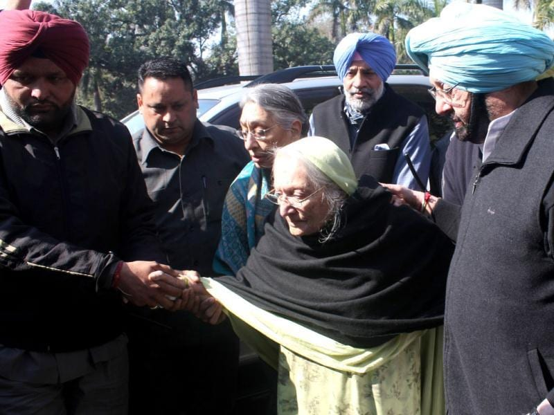 Amarinder Singh, a Congress candidtae contesting the Assembly polls brings his mother to a polling booth. HT Photo/ Bharat Bhushan