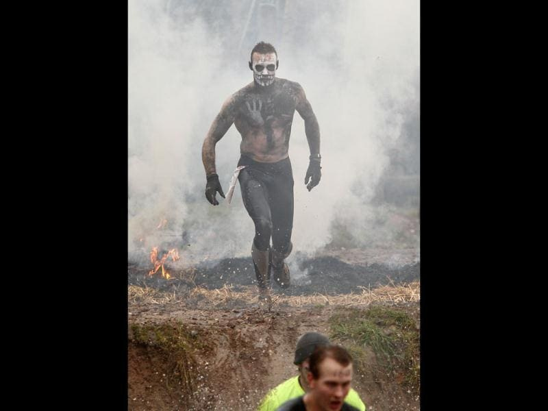 A competitor emerges from a water obstacle at the annual Tough Guy event, Perton, England. Tough Guy claims to be the world's most demanding one-day survival ordeal. First staged in 1986, it has been widely described as