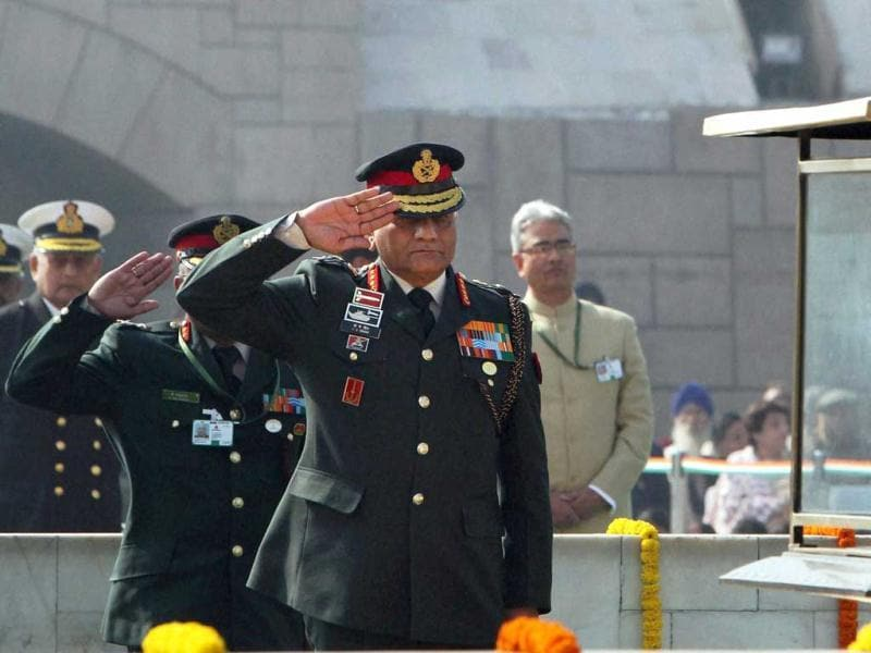 Army chief Gen V K Singh pays tribute to father of the Nation Mahatma Gandhi on his death anniversary, observed as Martyrs' Day, at Rajghat in New Delhi. PTI Photo by Vijay Verma