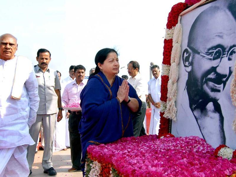 Tamil Nadu chief minister J Jayalalithaa paying tribute to Mahatma Gandhi on the occasion of his death anniversary, observed as Martyrs Day, in Chennai. Governor K Rosaiah is also seen. PTI Photo by R Senthil Kumar